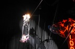 Motorcycle and trapeze artist on a wire