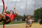Swinging at the park with his daddy.